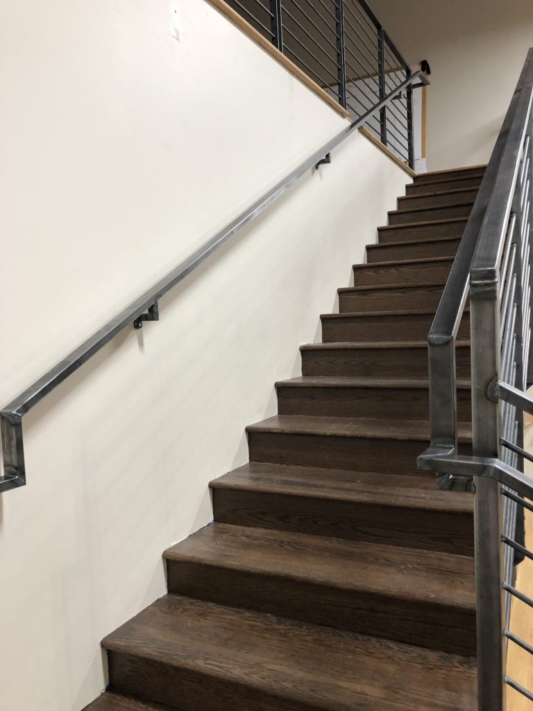 Heading up to the mezzanine of this commercial space, notice the gooseneck bends as we create a seamless system!