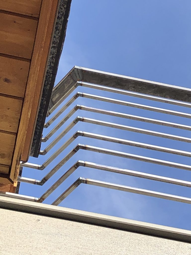 We couldn't terminate into the wall because the roof juts out over the balcony so created a compound angle. The client LOVES it!