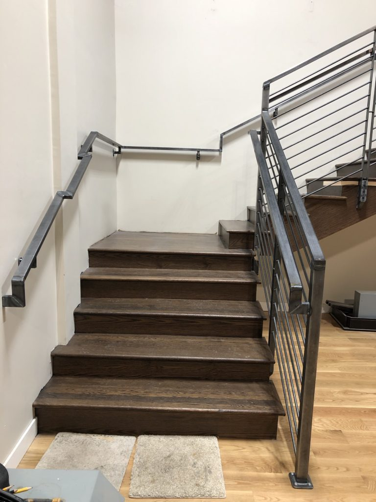This buildout needed a guardrail plus handrail system to go from the main floor to the mezzanine. Notice all the funky angles against the wall for the handrail; had fun figuring the math to make this all work!